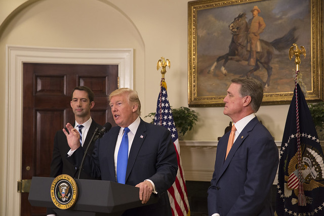 President Donald Trump (center) is considering a plan to send undocumented immigrants to sanctuary cities as a form of political retribution. Sens. Tom Cotton (left) and David Perdue (right) are co-sponsors of a bill that seeks to drastically reduce legal immigration to the U.S. Both proposals are garbage steeped in prejudice. (Photo Credit: The White House/Flickr)